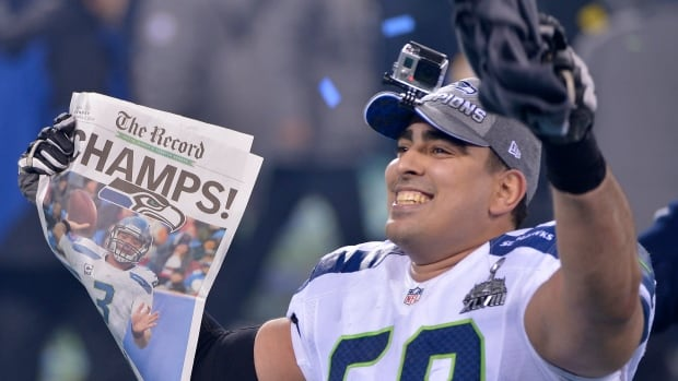Seattle Seahawks' Breno Giacomini celebrates after the Super Bowl XLVIII against the Denver Broncos.
