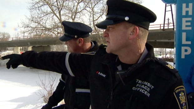 Calgary Transit peace officers D'Arcy Hare, right, and Bob Hope were driving south over the Langevin bridge when they spotted someone in the Bow River hanging onto the ice.