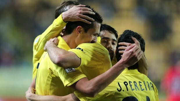 Villarreal's French forward Jeremy Perbet, left, celebrates his second goal with teammates against Osasuna at El Madrigal stadium in Villareal on Monday.