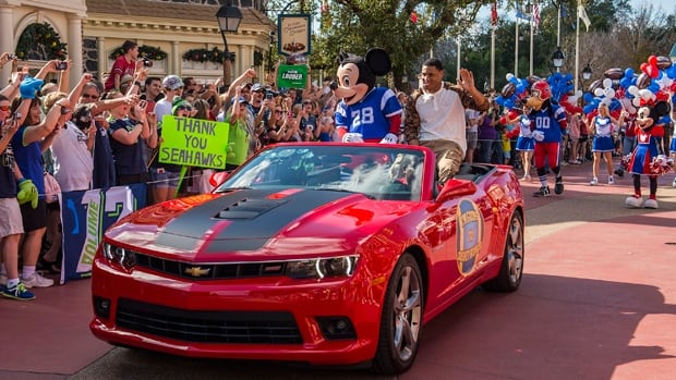 Super Bowl MVP Malcolm Smith parades through the Magic Kingdom at Walt Disney World in Lake Buena Vista, Fla., on Monday.