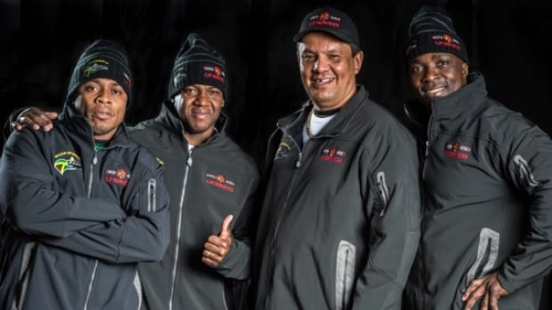 Alberta businessman and Chipewyan Prairie Dene First Nation chief Vern Janvier poses with members of the Jamaican bobsled team in Wyoming.