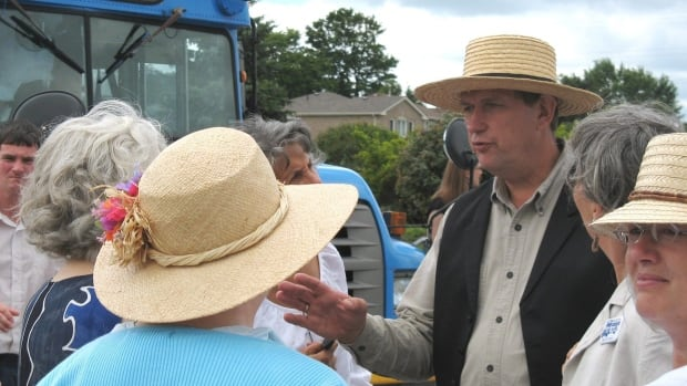 Michael Schmidt, seen speaking with supporters in a July 31, 2008 photo, has spent years fighting with the province over the issue of raw milk.