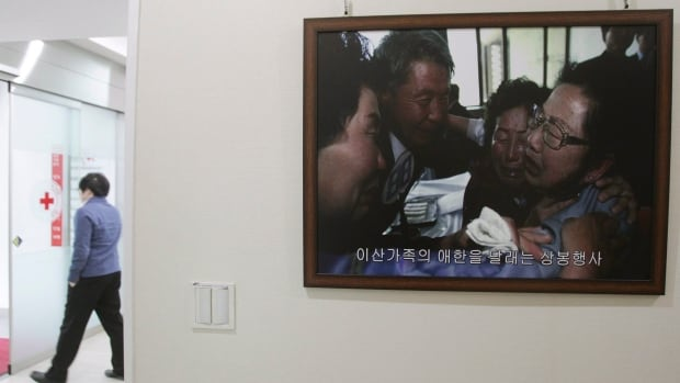 A picture of the reunion of family members from North and South Korea in 2010 is displayed at the headquarters of the Korea Red Cross in Seoul.