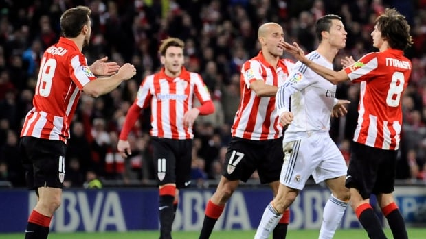 Real Madrid's Cristiano Ronaldo, second right, was shown a straight red for swiping his