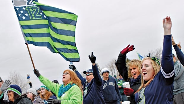 Hundreds gathered at Columbia Point Park in Richland, Wash., on Saturday, Feb. 1, 2014, to rally in support of the Seahawks the day before the Super Bowl.