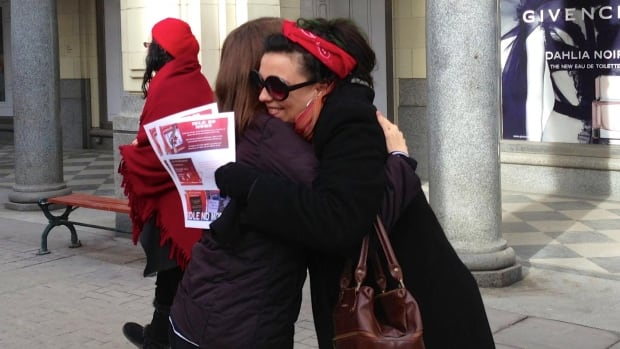 Calgary artist Deb Desmarais gives a stranger a hug last year during the inaugural Hug a Non-Native Day Feb. 6. A group led by Michelle Thrush was out in Calgary again Thursday for another round of hugs.