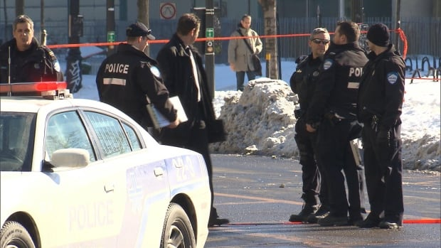 Officers gather in downtown Montreal on Monday afternoon after a police shooting killed Alain Magloire, a 41-year-old man with mental health problems who was wielding a hammer.