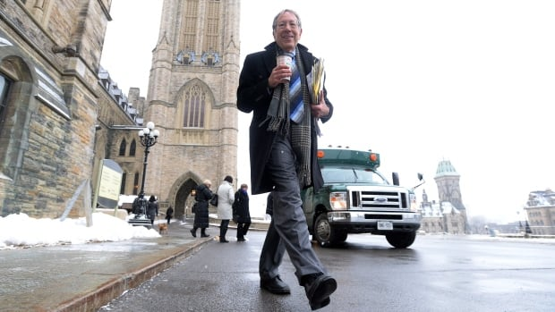 Veteran Liberal MP and former minister of justice Irwin Cotler makes his way to the House of Commons on Parliament Hill in Ottawa on Wednesday. Cotler announced he will not be running in the next federal election.
