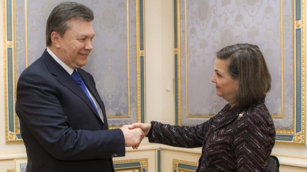Ukraine's President Viktor Yanukovich (left) welcomes U.S. Assistant Secretary of State for European and Eurasian Affairs Victoria Nuland during a meeting in Kyiv Feb. 6, 2014.