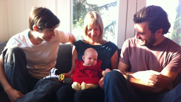 Anna Richards, Danielle Wiley and Shawn Kangro show off their three-month-old  daughter Della Wolf Kangro Wiley Richards in 2014. She is the first child in Canada to have three parents on her birth certificate.