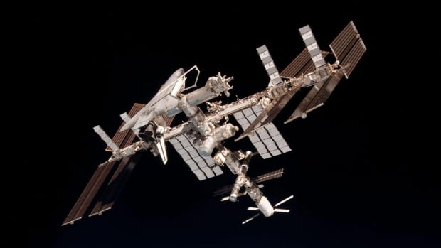 The Canadarm protrudes from U.S. space shuttle Endeavour,  which is attached to the International Space Station,  during a 2011 mission. Canada's space program took a giant leap on Friday, with new commitments from Ottawa.