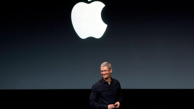 Apple's stock closed at a record high Tuesday with investors anticipating new product launches in the fall.