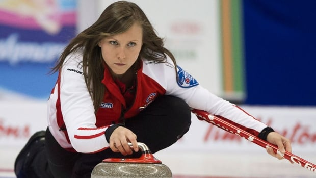 Team Canada skip Rachel Homan delivers her rock to team New Brunswick during Tournament of Hearts competition Friday in Montreal. Homan posted a 7-3 win to finish round-robin play with a 11-0 record.