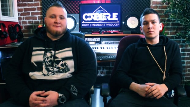 Corey LeRue (left) and Adrian Morris are members of Halifax's hip-hop scene and decided to use the online video trend known as neknominate to give back to their community.