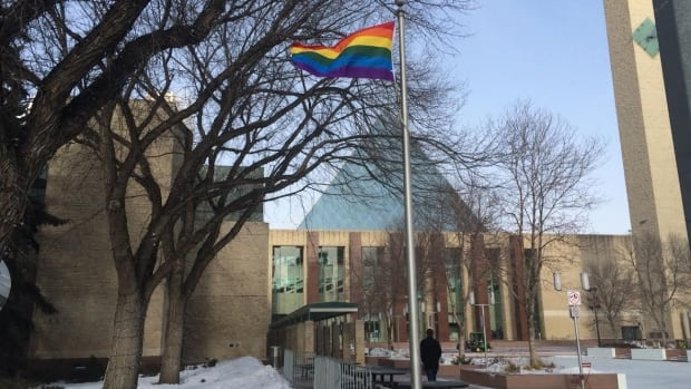 The pride flag flies outside Edmonton city hall Friday.