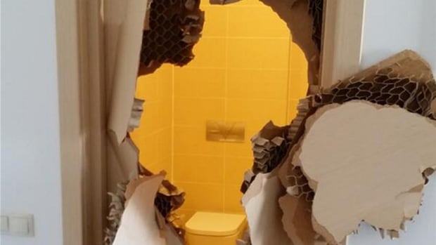 American bobsledder Johnny Quinn says he had to break through this bathroom door in Sochi after it became jammed or locked and he couldn`t get out.