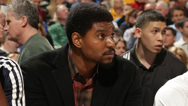 Pacers newcomer Andrew Bynum looks on from the bench during Friday's game against Portland. He joined the team earlier in the day for shootaround for the first time since signing with the NBA team a week ago. Bynum will be eased into the lineup, according to Indiana coach Frank Vogel.