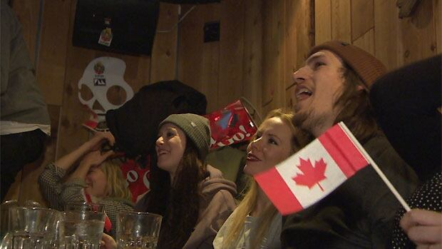 Canada snowboard team members and fans cheer Regina's Mark McMorris early Saturday morning in Whistler