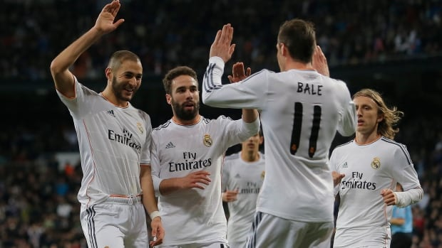 Real Madrid players celebrate a goal against Villarreal at the Bernabeu stadium in Madrid, Spain, Saturday, Feb. 8, 2014.