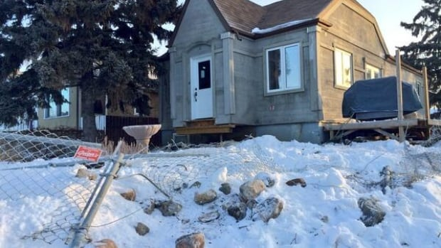 The Regina house that police say a stolen car crashed into late Saturday night.