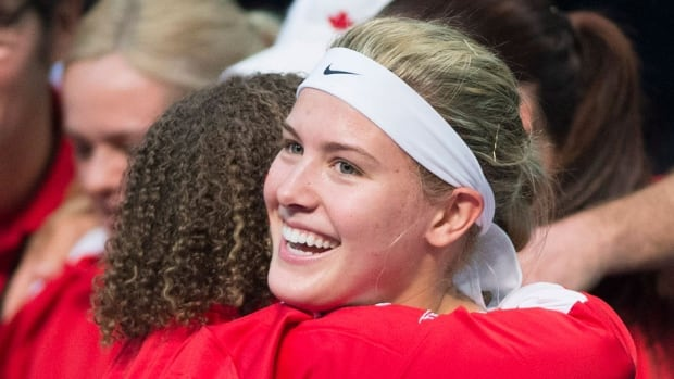 Canada's Eugenie Bouchard celebrates with a member of her team after defeating Vesna Dolonc from Serbia during Fed Cup action in Montreal on Sunday. The Canadians improved their record to 3-0 to clinch a playoff berth.