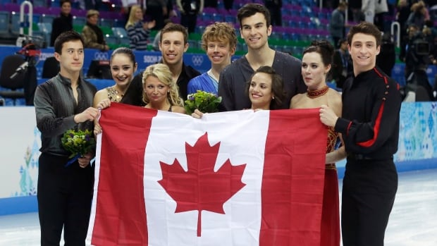 Kaetlyn Osmond, second from left, stands with the rest of Team Canada after the flower ceremony in the Iceberg Skating Palace in Sochi. The Canadians earned a silver medal in the competition - Osmond's first Olympic win.