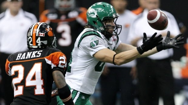 Saskatchewan Roughriders' Johnny Quinn goes for the ball but fails to make the catch as B.C. Lions' Korey Banks defends during second half CFL action in Vancouver, B.C., on Friday August 7, 2009.