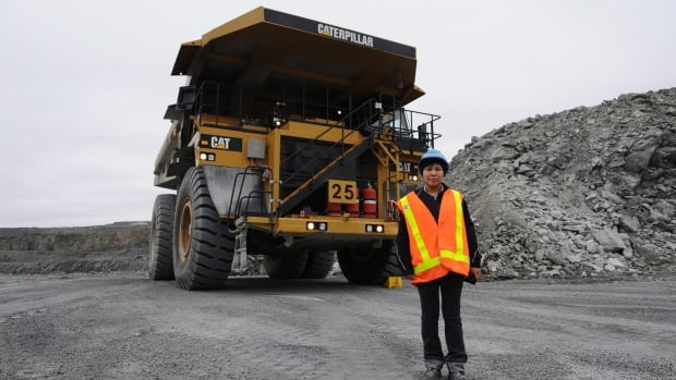 Inuit truck driver Billie-Jo Ban  Eindhoven, 24, of Rankin Inlet is seen with her truck in the open pit mine at Agnico-Eagle's Meadowbank Mine facility in Meadowbank Mine, Nunavut on Wednesday, August 24, 2011.  Sean Kilpatrick