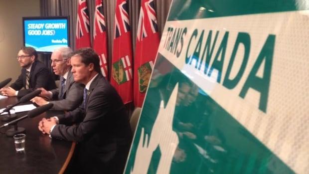 Steve Ashton (centre) announces $213 million in upgrades to Highway 1 west of Winnipeg.