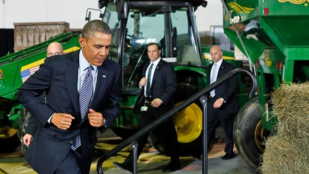 U.S. President Barack Obama takes to a stage backed with harvesters and hay on Friday as he travelled to Michigan to sign the nearly $1 trillion farm bill into law. The law cuts direct farm subsidies but replaces them with more generous government-paid crop insurance.