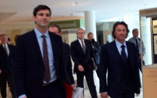 Mayor Don Iveson and Oilers owner Daryl Katz stroll into a news conference Tuesday at city hall.