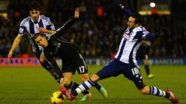 Eden Hazard (17) of Chelsea is tackled by Morgan Amalfitano in a 1-1 draw with West Brom at The Hawthorns on Tuesday.