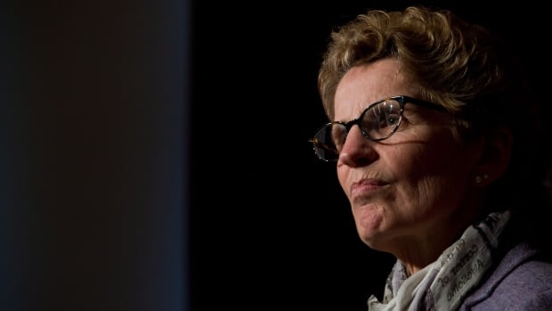 Ontario Premier Kathleen Wynne, seen speaking with reporters earlier this month, says that the federal government is getting out of the business of 'nation building.'