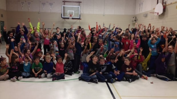 More than 200 people, including the entire student population, packed the gymnasium at the Golden Learning Centre in Balmertown, Ont., Wednesday morning, to watch Eric Radford compete in the Sochi 2014 Winter Olympic Games.