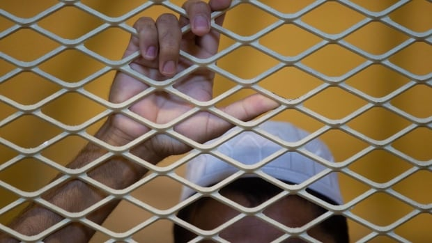 A detainee stands inside a cell inside the Parwan detention facility in Afghanistan in 2010. The Afghan government has released 65 prisoners, despite U.S. protests that they are highly dangerous, the latest sign of deteriorating relations between the two countries ahead of the year-end withdrawal of most international combat troops.