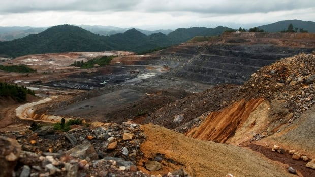 Barrick Gold, whose Pueblo Viejo gold mine in the Dominican Republic is shown above, has reduced its gold reserves to 104.1 million ounces at the end of 2013 from 140.2
