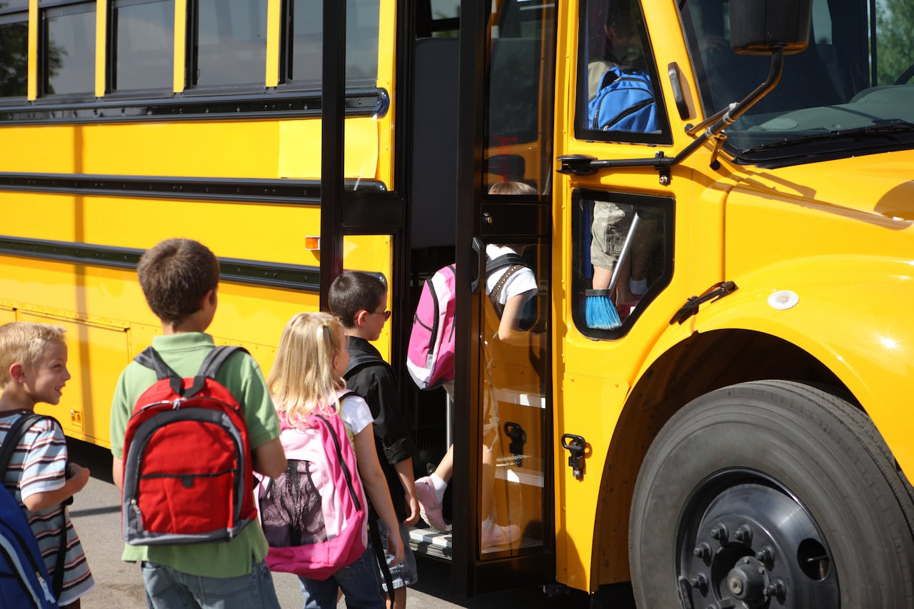Image result for kids getting on school bus free photo