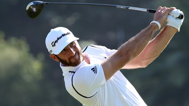 Leader Dustin Johnson hits a tee shot in the opening round of the Northern Trust Open at Riviera Country Club on Thursday.