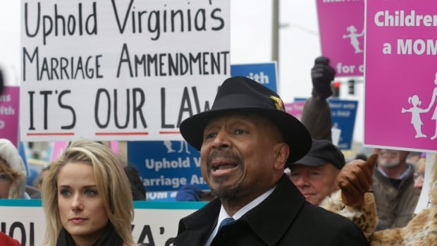 Former Republican candidate for Lt. Gov. E.W. Jackson, front center, spoke to the media in favour of the law banning same-sex marriage during a demonstration outside Federal Court in Norfolk, Va., on Feb 4.