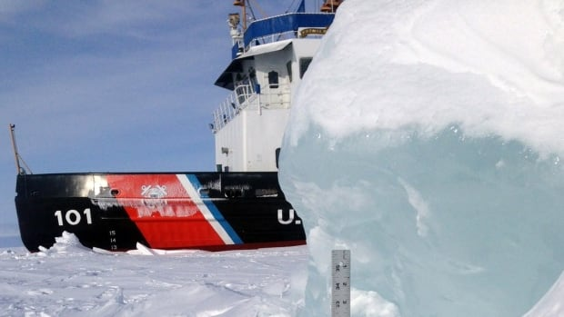 In this Feb. 5 photo photo provided by the U.S. Coast Guard, a yardstick measures the thickness of some of the ice the crew of cutter Katmai Bay battles during ice-breaking operations in the Straits of Mackinac. The icebreaker Mackinaw maintains a shipping lane on the Great Lakes which are almost completely covered with ice for the first time since 1994.