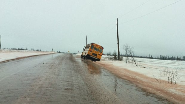 A school bus in North Tryon slid off the road and into the ditch.