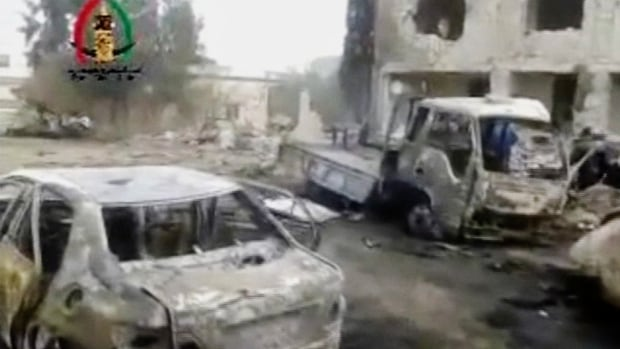Vehicles smoldered after a car bomb blew up outside a mosque in Yadouda, Syria on Feb. 14, 2014 in this image made from video obtained from the Shaam News Network. Dozens of people were killed, filling clinics and hospitals with the wounded, anti-government activists said.