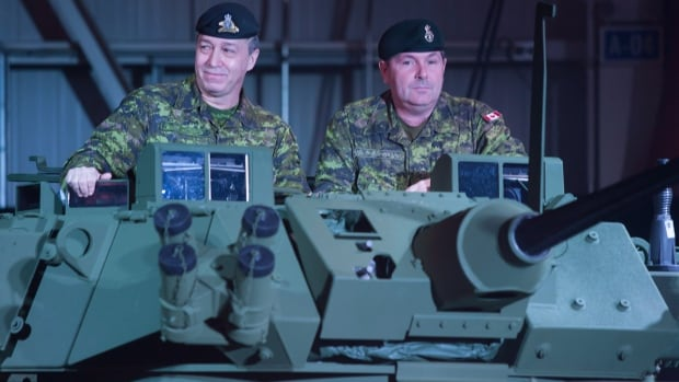 Canadian soldiers are shown in an upgraded light armoured vehicle unveiled at a news conference at a General Dynamics facility in London, Ont., on Jan. 24, 2012. General Dynamics has won a $10-billion US deal to provide armoured vehicles to Saudi Arabia.