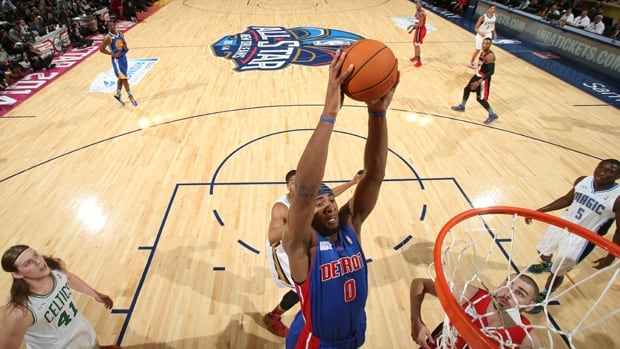 Andre Drummond (0) of Team Hill dunks in a 142-136 victory over Team Webber in the Rising Stars Challenge on Friday night.