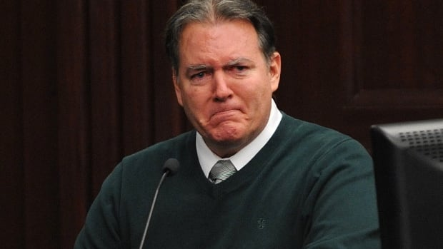 Defendant Michael Dunn reacts on the stand during testimony in his own defence during his murder trial in February.