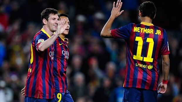 Lionel Messi of FC Barcelona celebrates with teammates after scoring against Rayo Vallecano on February 15, 2014 in Barcelona, Spain.
