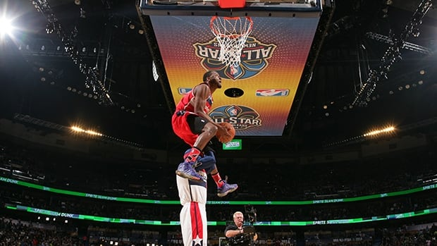 John Wall dunks during the slam dunk contest Saturday Night as part of the 2014 All-Star Weekend at Smoothie King Center on February 15, 2014 in New Orleans, Louisiana.