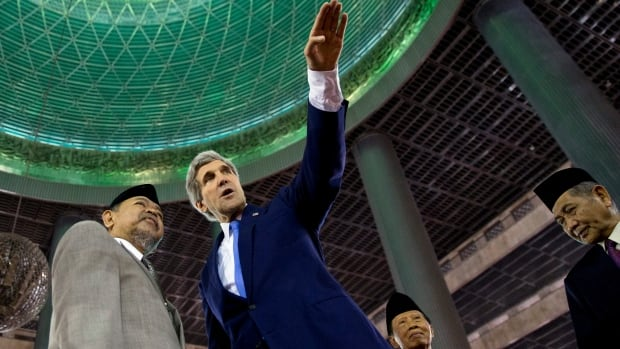 U.S. Secretary of State John Kerry, right, tours the Istiqlal Mosque with Grand Imam K.H. Ali Mustafa Yaqub on Sunday in Jakarta.
