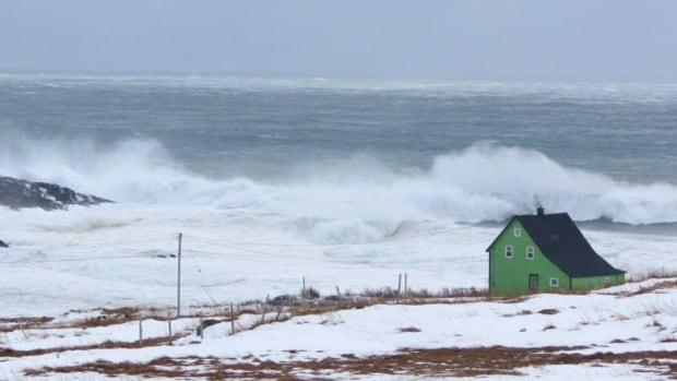 A storm surge in Lord's Cove on Saturday blasted the coast with waves, as severe wind battered Newfoundland.