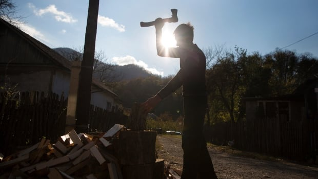 A Circassian villager chops wood in Tkhagapsh in the Lazerevskoye district of Sochi on Oct. 26, 2013. Circassians are a people indigenous to the North Caucasus region, most of whom were scattered across the globe by a 19th century tsarist military campaign that caused the deaths of huge numbers.
